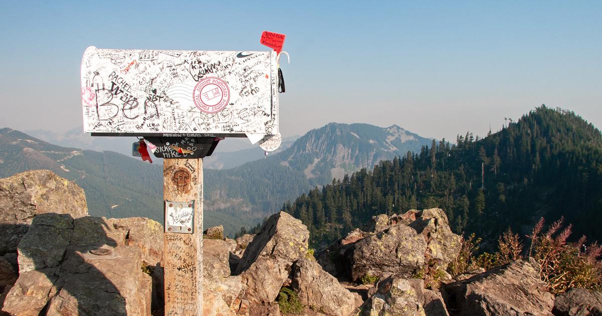 graffiti on mailbox on top of mountain